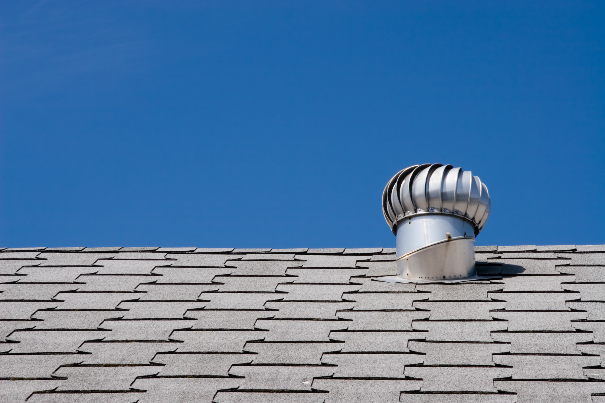 Roof of commercial building with exhaust vent.